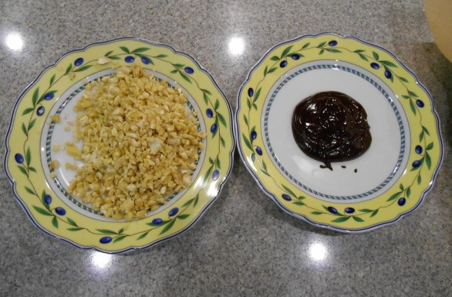 Put the melted chocolate and the chopped nuts on separate plates;