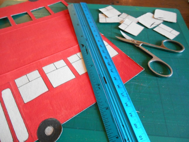 First I re-opened the cardboard model and carefully cut out its windows with a tiny pair of nail scissors