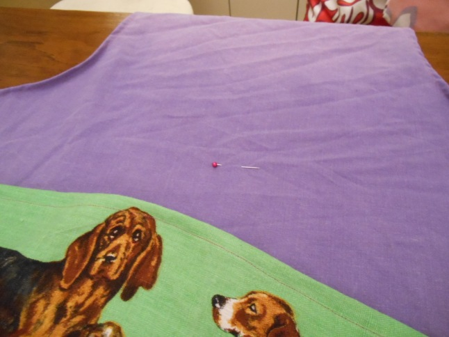 put on apron and mark with pin where centre top of pocket will be