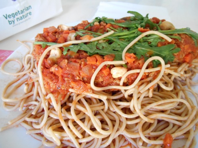 Take away food in paper bag from Greenway vegetarian restaurant.  Vegan Spaghetti bolognese.