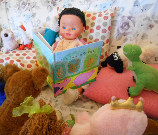 This image has an empty alt attribute; its file name is reading-the-two-little-pigs-vegan-storybook.png